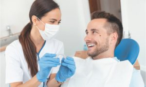 The dentist offers clear aligners for the patient.