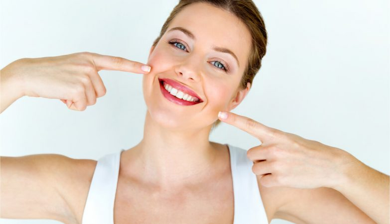 The woman is happy to have a healthy smile.